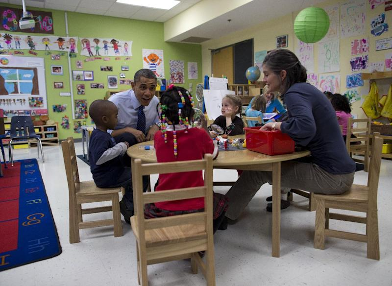 President Barack Obama visits a pre-kindergarten classroom at College Heights Early Childhood Learning Center in Decatur, Ga., Thursday, Feb. 14, 2013. The president is traveling to promote his economic and educational plan that he highlighted in his State of the Union address. (AP Photo/ Evan Vucci)