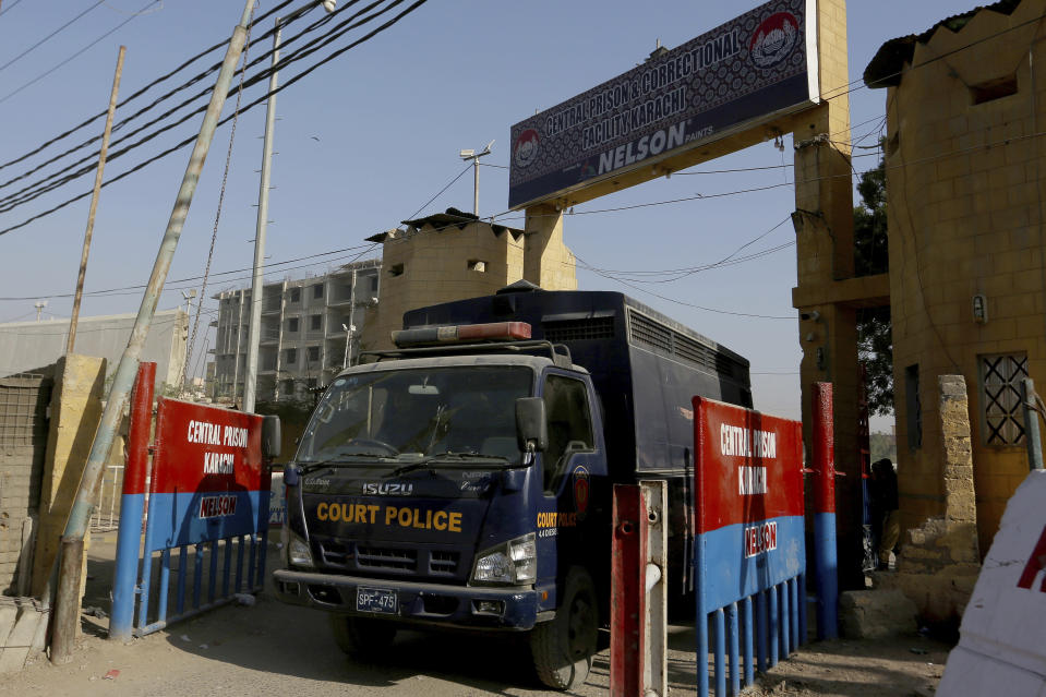 A police van is driven out from the Karachi Central Prison where British-born Pakistani Ahmed Omar Saeed Sheikh, who was charged, convicted and later acquitted in the 2002 murder of American journalist Daniel Pearl, is detained, in Karachi, Pakistan, Friday, Jan. 29, 2021. Pakistan is scrambling to manage the fallout of a Supreme Court decision to free the Pakistani-British man accused in the 2002 beheading of American Journalist Daniel Pearl. The Sindh Provincial government on Friday filed a review petition, asking the same court to revisit its decision. (AP Photo/Fareed Khan)