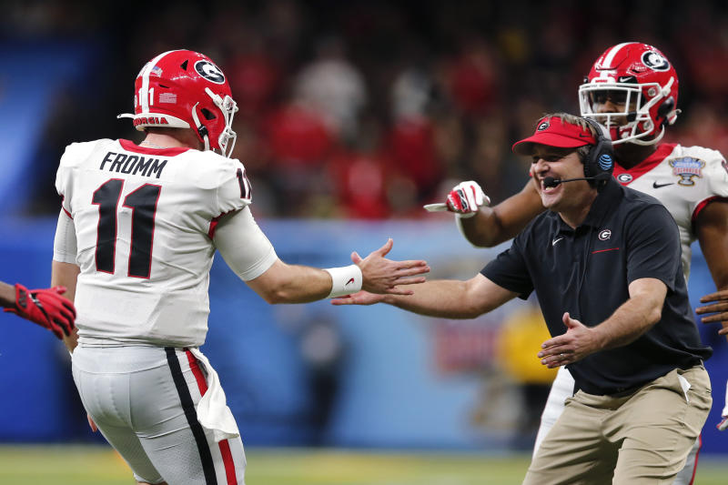 Georgia head coach Kirby Smart greets quarterback Jake Fromm (11) after a touchdown pass in the second half of the Sugar Bowl NCAA college football game against Baylor in New Orleans, Wednesday, Jan. 1, 2020. (AP Photo/Brett Duke)