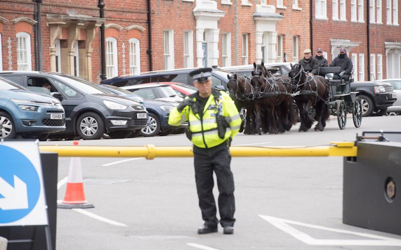 The Duke of Edinburgh was also seen driving his carriage behind security barriers while a police stood guard - Credit: Paul Grover for the Telegraph
