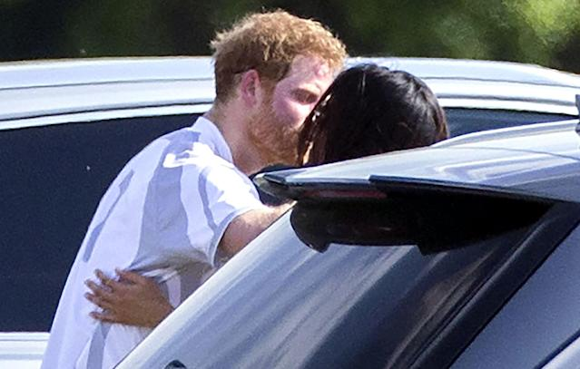 <p>Harry was spotted giving his girlfriend a kiss after taking part in the Audi Polo Challenge in May. With Markle supporting her partner on the sidelines, it was the first time the pair were seen in public together. (Photo: Rex) </p>