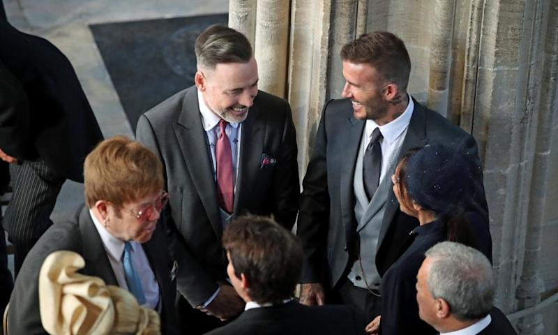 Sir Elton John (L) and David Furnish (2nd L) with the Beckhams inside the chapel.