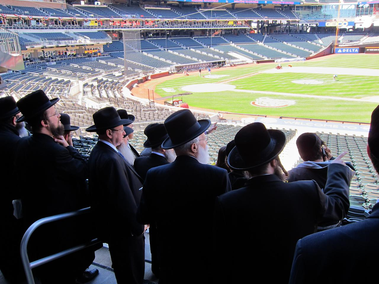In this April 3, 2012 photo provided by VosIzNeias.com, a group of Ultra Orthodox Jews who believe that the Internet threatens their way of life, check out the facilities at New York's Citi Field, which they ultimately rented for an unprecedented gathering. The upcoming May 20 rally at the Mets' Stadium will address how to use modern technology in a religiously appropriate way. More than 40,000 ultra-Orthodox Jewish men plan to pack Citi Field for the Sunday evening gathering on the dangers of the Internet, and organizers have also rented the nearby Arthur Ashe Stadium for the overflow crowd. (AP Photo/VosIzNeias.com) MANDATORY CREDIT