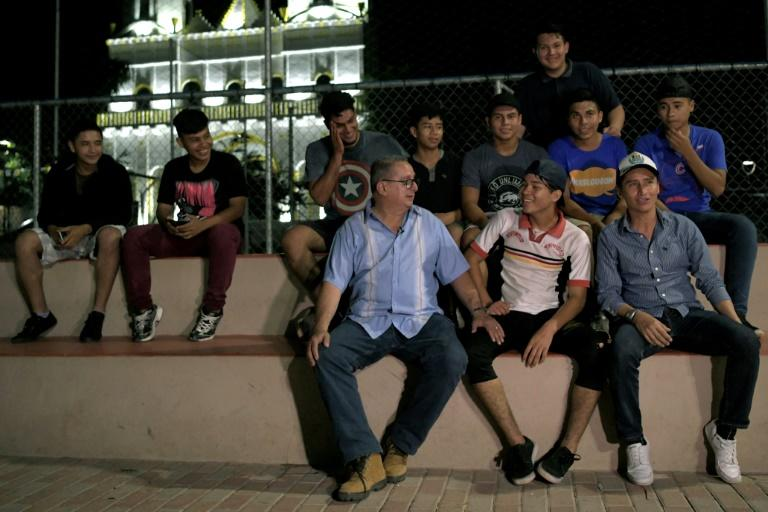 San Jose Guayabal mayor Mauricio Vilanova (center) tries to convince local youth to resist gang recruitment and play sports