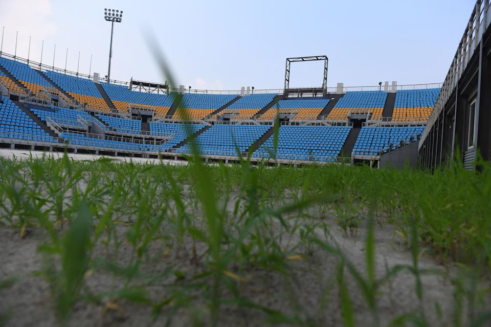 This photo taken on July 23, 2018 shows grass growing in the Beach Volleyball stadium built for the 2008 Beijing Olympic Games, in Beijing. - A decade after Beijing hosted the 2008 Olympics, its legacy remains unmistakable from the smallest alleyways in the Chinese capital to the country's growing clout abroad. For better or worse, the Games changed the face of Beijing: from the iconic Bird's Nest stadium to the countless blocks of ancient homes bulldozed in an Olympic building frenzy. (Photo by GREG BAKER / AFP) / TO GO WITH China-politics-Olympics-anniversary,FOCUS by Ben Dooley        (Photo credit should read GREG BAKER/AFP via Getty Images)