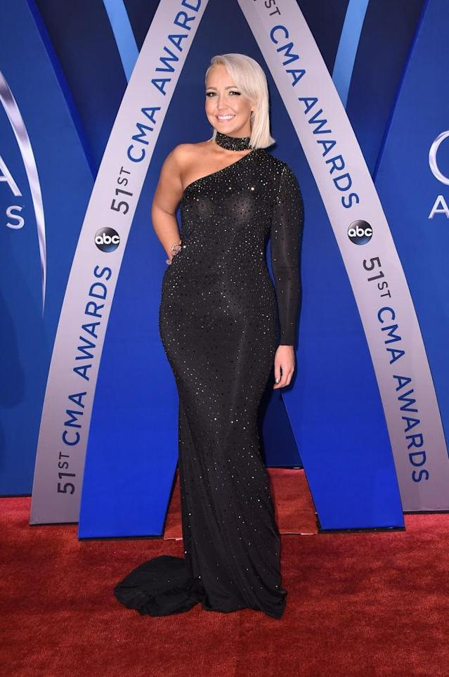 <p>The star shined in a bedazzled black off-the-shoulder dress. (Photo: Getty Images) </p>
