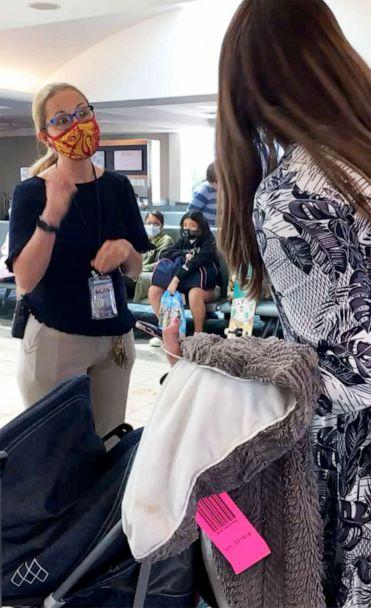 PHOTO: Chaya Bruck confronts a gate agent in Orlando, Fla after her six children were kicked off of an Orlando JetBlue Airways flight in August because her 2-year-old daughter refused to wear a mask. (Courtesy of Chaya Bruck)