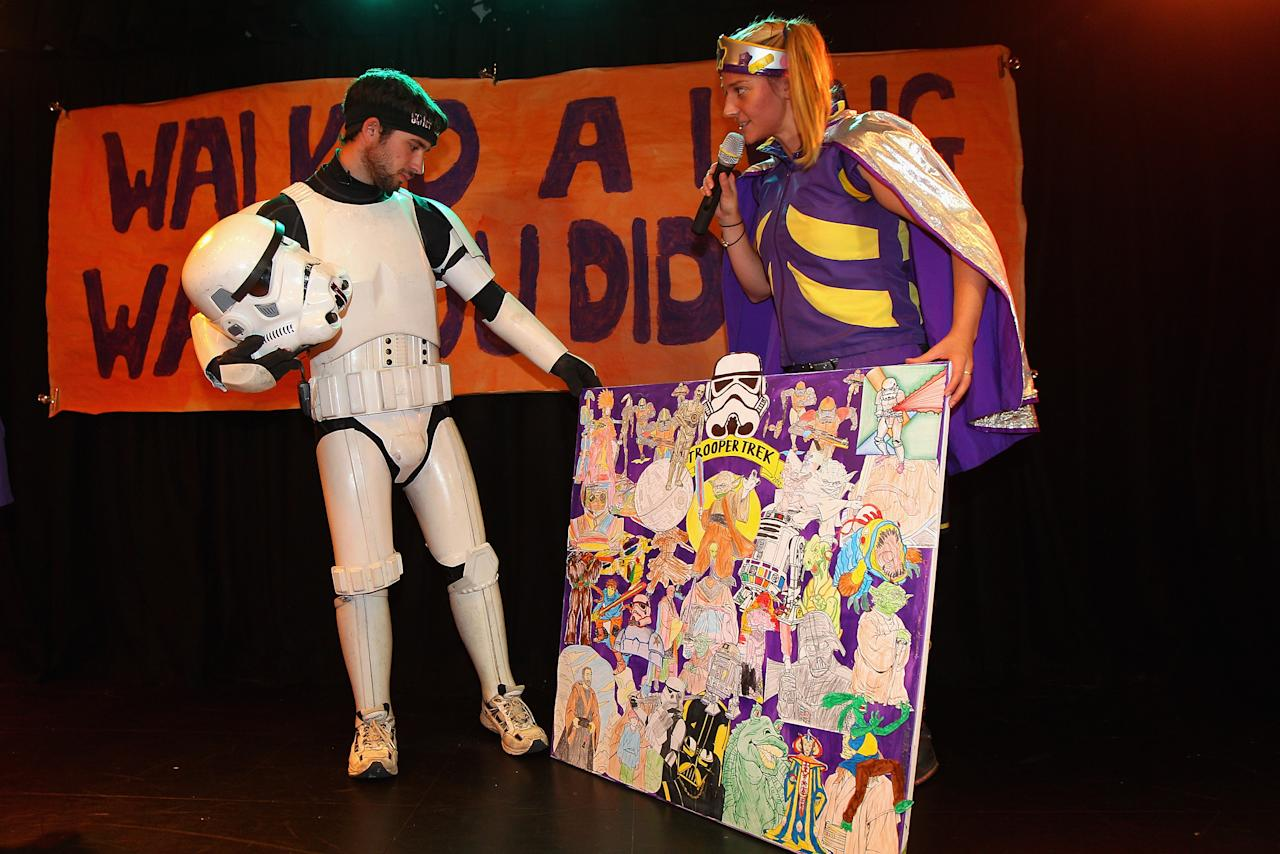 Jacob French receives an artwork after completing his trek at the Sydney Children's Hostpital on April 4, 2012 in Sydney, Australia. French today completed the over 5,000 km trek from Perth to Sydney on foot, donning a full body stormtrooper costume he successfully raised over $100,000 for the Starlight Children's Foundation. Since July 2011, Jacob has walked 10 hours a day, Monday to Friday, lost over 12kg in weight, and gone through seven pairs of shoes. The Starlight Children's Foundation provides programs to help lift the spirits of sick children in hospitals accross Australia.  (Photo by Cameron Spencer/Getty Images)