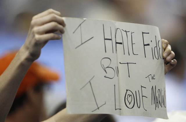 "A Miami Marlins fan holds up a sign which reads ""I hate Fidel but I love the Marlins"" during a baseball game against the Houston Astros, Friday, April 13, 2012, in Miami. Marlins manager Ozzie Guillen was suspended for five games due to comments he made expressing admiration for Fidel Castro. The Marlins won 5-4 in eleven innings. (AP Photo/Lynne Sladky)"