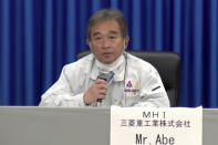 In this image made from a video, Naohiko Abe of Mitsubishi Heavy Industries, Ltd., attends a news conference at Tanegashima Space Center on a small southern Japanese island after a launch of a United Arab Emirates spacecraft Monday, July 20, 2020. A United Arab Emirates spacecraft rocketed away Monday on a seven-month journey to Mars, kicking off the Arab world's first interplanetary mission. (MHI via AP Photo)