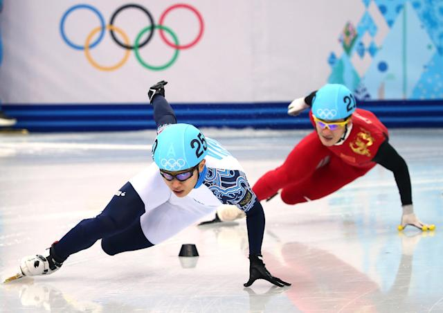 SOCHI, RUSSIA - FEBRUARY 21: Victor An (L) of Russia and Wenhao Liang of China compete in the Short Track Men's 500m Semifinals on day fourteen of the 2014 Sochi Winter Olympics at Iceberg Skating Palace on February 21, 2014 in Sochi, Russia. (Photo by Ryan Pierse/Getty Images)