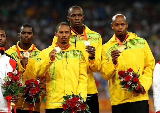"Nesta Carter, Michael Frater, Usain Bolt and <a class=""link rapid-noclick-resp"" href=""/olympics/rio-2016/a/1057256/"" data-ylk=""slk:Asafa Powell"">Asafa Powell</a> of Jamaica receive their gold medals at the Beijing 2008 Olympic Games. (Getty Images)"