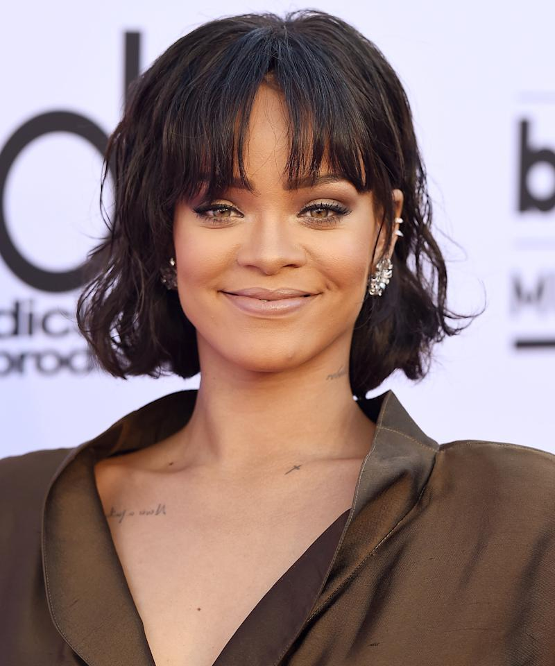 """<p>Rihanna's long, eye-grazing bangs that are tapered on the sides add a soft element to square face shapes. When you're at the salon, ask your stylist to snip them just below the brows, leaving the heaviest pieces on the sides so they don't mask your eyes. The center strands can be feathery as a little forehead peeking through is ideal. """"Heavy bangs like this need to hit the right place, otherwise, they can easily overwhelm your face,"""" stylist Andy Lecompte previously told <em>InStyle</em>.</p>"""