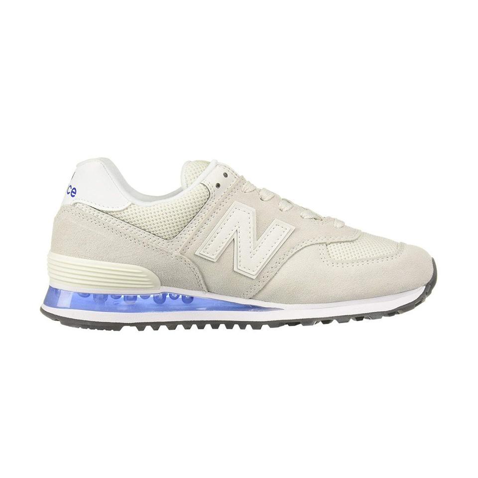 """<p>For long trips where you're schlepping all over town, these New Balances come with removable memory foam insoles to cushion your feet.</p> <p><strong>Buy it:</strong> $60 (originally $80), <a href=""""https://www.zappos.com/p/new-balance-classics-574-translucent-white-uv-blue/product/9188345/color/778255"""" rel=""""nofollow"""">zappos.com</a></p>"""