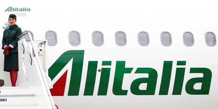 Alitalia's flight attendant is seen at the Leonardo da Vinci-Fiumicino Airport in Rome