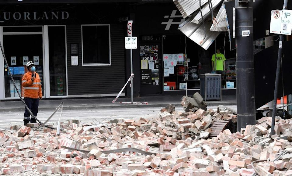 Bricks cover the footpath outside a Chapel Street building damaged in the earthquake.