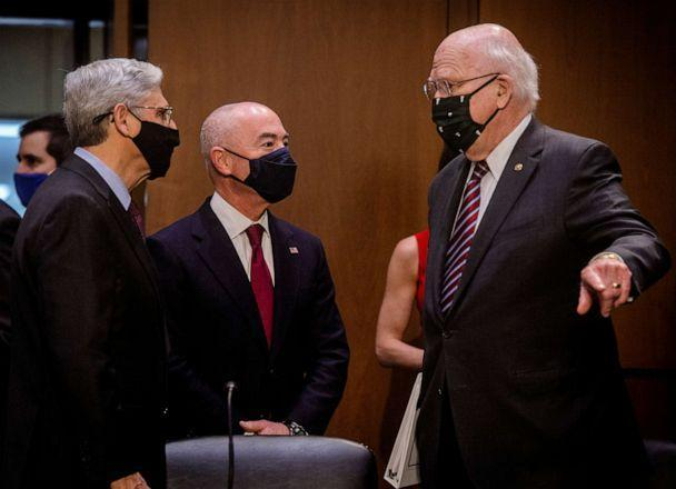 PHOTO: Attorney General Merrick Garland and Homeland Security Secretary Alejandro Mayorkas chat with Sen. Patrick Leahy before the Senate Appropriations committee hearing to examine domestic violent extremism, on May 12, 2021, in Washington. (Bill O'Leary/Pool via Getty Images)