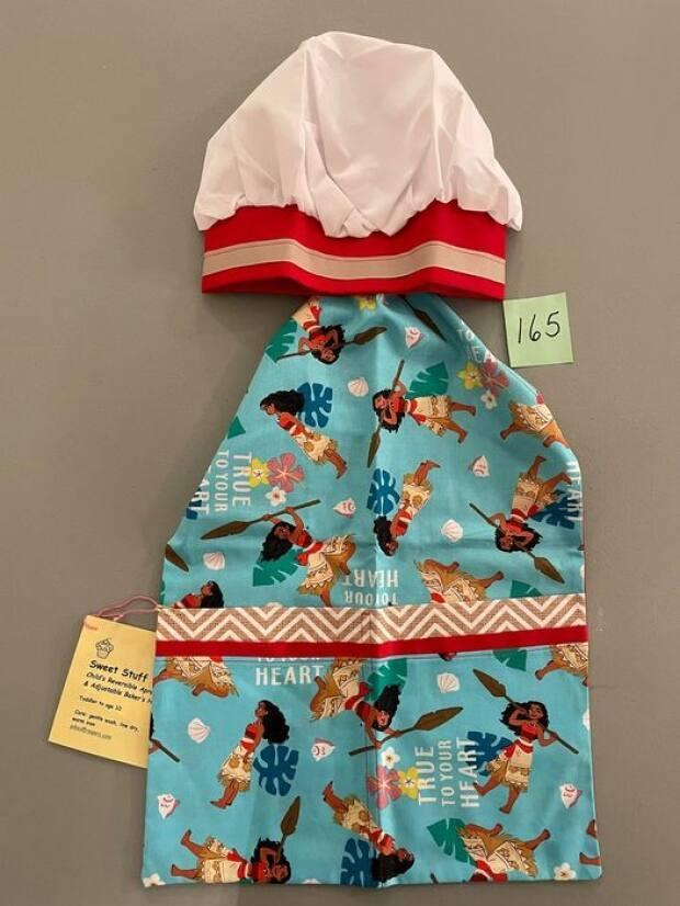 A number of handmade child's apron sets are among the items that have been donated for the Friends of Shamsa Online Auction.