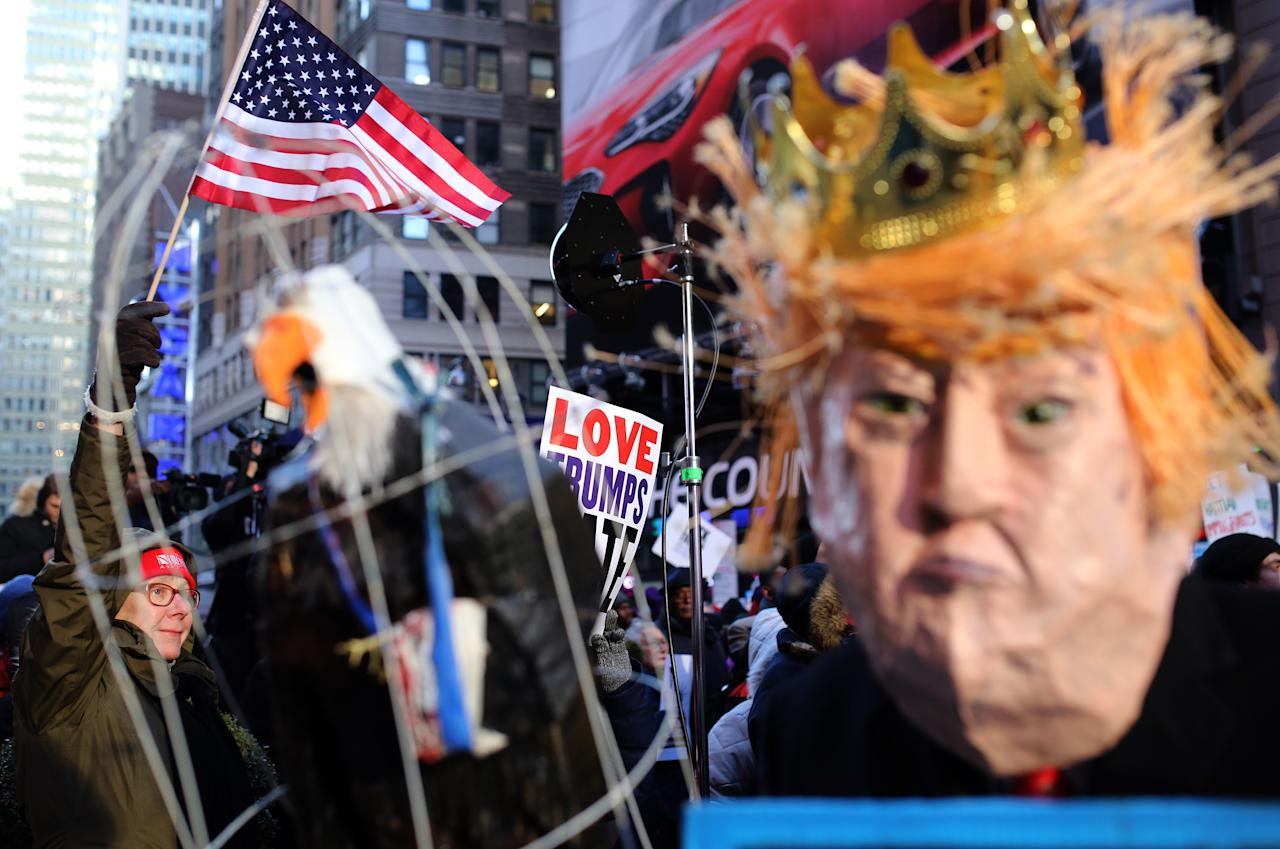 <p>Hundreds of people gather and organized a demonstration in Times Square with demand of love, respect and reunion of immigrants during the death anniversary of Martin Luther King in New York City on Jan.15, 2018. (Photo: Atilgan Ozdil/Anadolu Agency/Getty Images) </p>