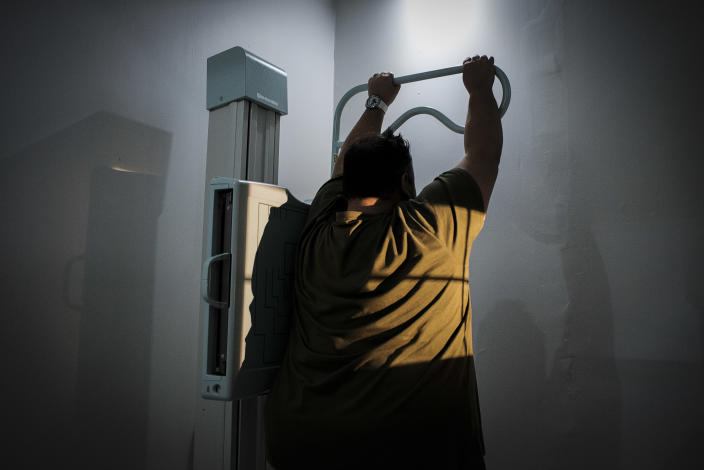 <p>Andre Hugo, 41, during the preoperative medical examination in the Chrysalis Clinic for the treatment of obesity, in the Life Kinksbury Hospital. Hugo weighs 372 lbs. (Photograph by Silvia Landi) </p>