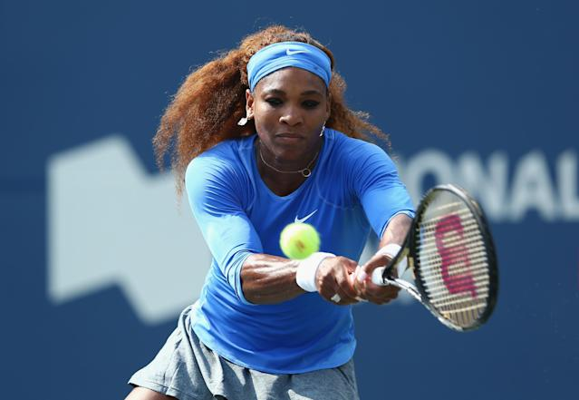 TORONTO, ON - AUGUST 08: Serena Williams hits a return in her 6-0, 6-3 win over Kirsten Flipkens of Belgium on day four of the Rogers Cup Toronto at Rexall Centre at York University on August 8, 2013 in Toronto, Ontario, Canada. (Photo by Andy Lyons/Getty Images)