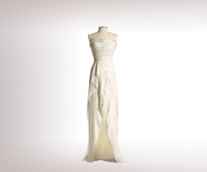 """J. Mendel's 'Melody' is ideal for a Cali bride like Jennifer,"" says <a target=""_blank"" href=""http://www.marthastewartweddings.com/dress-finder"">Martha Stewart Weddings</a> assistant fashion editor Carrie Goldberg. ""The crinkle silk chiffon is classic yet easy, and the neckline shows off athletic, toned arms – Aniston to a T. The small slit in the skirt will flash a little leg as she walks down the aisle and dances into the night."" <p><em>Follow Carrie on Twitter <a target=""_blank"" href=""https://twitter.com/carrielauren"">@carrielauren</a>.</em> </p>"