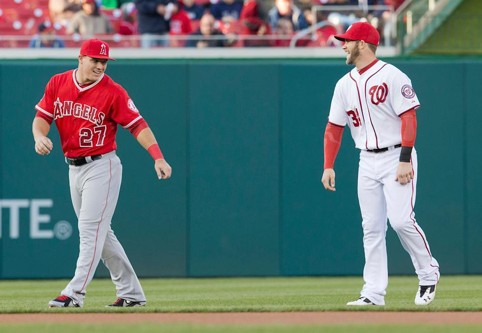 Los Angeles Angels Mike Trout, left, and Washington Nationals Bryce Harper, right, during warm ups before the start of their baseball game, Wednesday, April 23, 2014 in Washington. (AP Photo/Pablo Martinez Monsivais)