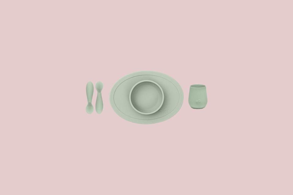 """<p>Most parents introduce solids to their baby at four to six months of age. This all-in-one placemat set comes with everything they need for mealtime— a bowl, cup, and spoon—all microwave and dishwasher safe.</p> <p><strong><em>Shop Now:</em></strong><em> Ezpz First Foods Set, in Sage, $35, <a href=""""http://www.anrdoezrs.net/links/7799179/type/dlg/sid/MSL25GiftsforaBabyShowerinaBoxDeliveryPackagerhaarsBabGal7845171202007I/https://www.bedbathandbeyond.com/store/product/ezpz-4-piece-first-foods-set-in-grey/5397366?brandId=4252"""" rel=""""nofollow noopener"""" target=""""_blank"""" data-ylk=""""slk:bedbathandbeyond.com"""" class=""""link rapid-noclick-resp"""">bedbathandbeyond.com</a></em><em>.</em></p>"""