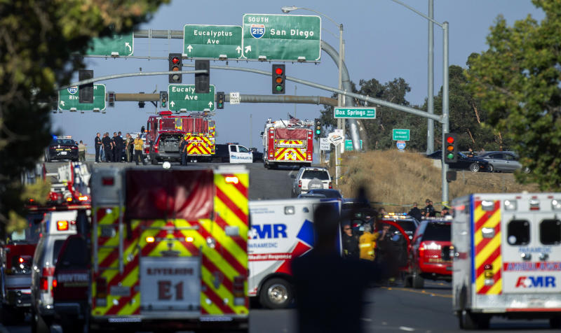 Authorities work the scene where a shootout near a freeway killed a California Highway Patrol officer and wounded two others before the gunman was fatally shot, Monday, Aug. 12, 2019, in Riverside, Calif. (Terry Pierson/The Orange County Register via AP)