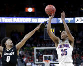 Colorado's D'Shawn Schwartz, left, covers a shot by Arizona's Allonzo Trier during the first half of an NCAA college basketball game in the quarterfinals of the Pac-12 men's tournament Thursday, March 8, 2018, in Las Vegas. (AP Photo/Isaac Brekken)