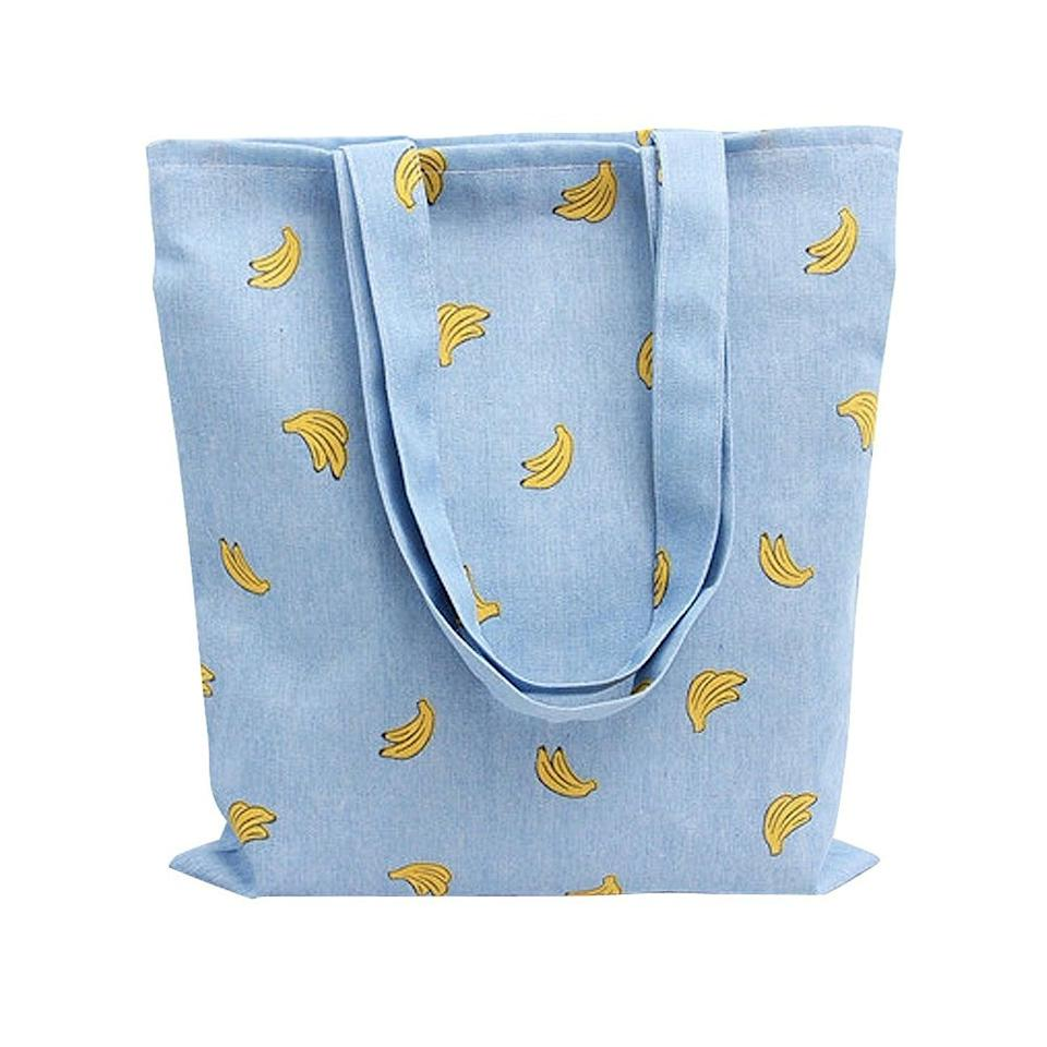 <p>Be the most stylish shopper at the grocery store when you carry the <span>Caixia Women's Cotton Banana Print Blue Canvas Tote Shopping Bag</span> ($10).</p>