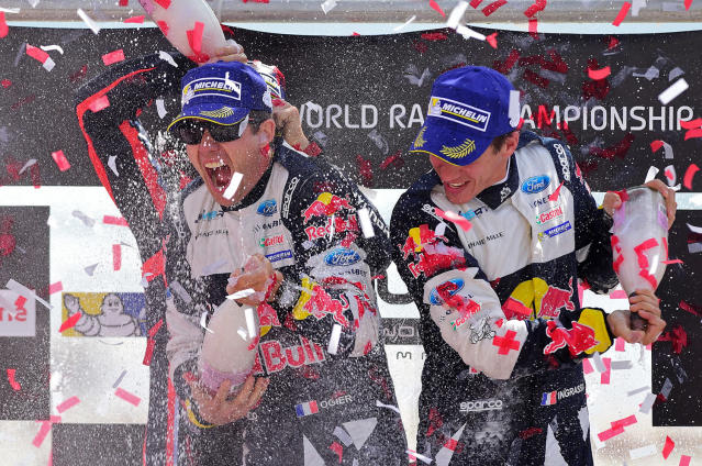 <p>French driver Sebastien Ogier, left, and co-driver Julien Ingrassia celebrate on the podium after winning the Portugal WRC rally in Matosinhos, northern Portugal, May 21, 2017. (Photo: Miguel Riopa/AFP/Getty Images) </p>