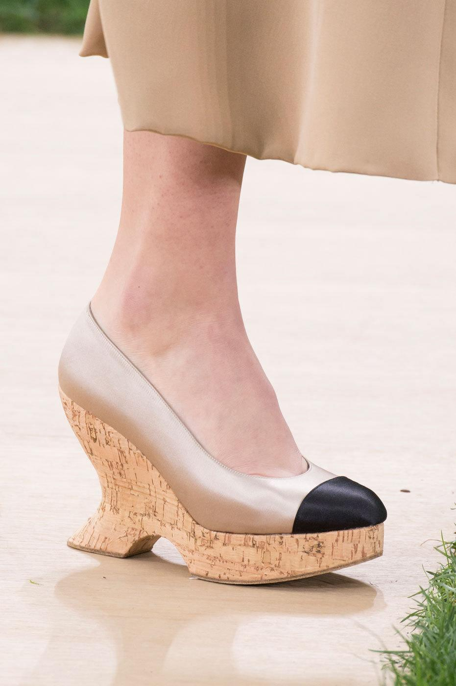 """<p>The flirty wedge just got in bed with a serious spectator pump for the ultimate ladylike look at <a href=""""http://www.chanel.com/en_US/"""" rel=""""nofollow noopener"""" target=""""_blank"""" data-ylk=""""slk:Chanel"""" class=""""link rapid-noclick-resp"""">Chanel</a>. <i>Photos: Imaxtree</i> </p>"""