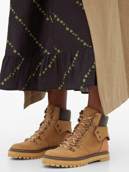 """<p>Hiking boots are one of the biggest Fall trends, and these <a href=""""https://www.popsugar.com/buy/See-Chlo%C3%A9-Foldover-Suede-Hiking-Boots-483082?p_name=See%20by%20Chlo%C3%A9%20Foldover%20Suede%20Hiking%20Boots&retailer=matchesfashion.com&pid=483082&price=443&evar1=fab%3Aus&evar9=45610650&evar98=https%3A%2F%2Fwww.popsugar.com%2Ffashion%2Fphoto-gallery%2F45610650%2Fimage%2F46526894%2FSee-by-Chlo%C3%A9-Foldover-Suede-Hiking-Boots&list1=shopping%2Cfall%20fashion%2Cshoes%2Cboots%2Cfall%2Cbooties&prop13=mobile&pdata=1"""" rel=""""nofollow"""" data-shoppable-link=""""1"""" target=""""_blank"""" class=""""ga-track"""" data-ga-category=""""Related"""" data-ga-label=""""https://www.matchesfashion.com/us/products/See-By-Chlo%C3%A9-Foldover-suede-hiking-boots--1307586"""" data-ga-action=""""In-Line Links"""">See by Chloé Foldover Suede Hiking Boots</a> ($443) are rugged while still feeling fashion forward.</p>"""