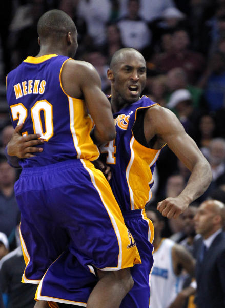 Los Angeles Lakers guard Kobe Bryant celebrates with guard Jodie Meeks (20) after scoring in the final minute of an NBA basketball game against the New Orleans Hornets in New Orleans, Wednesday, March 6, 2013. The Lakers won 108-102. (AP Photo/Gerald Herbert)