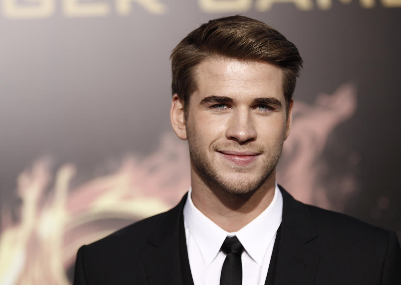 """Liam Hemsworth arrives at the world premiere of """"The Hunger Games"""" on Monday March 12, 2012 in Los Angeles. (AP Photo/Matt Sayles)"""