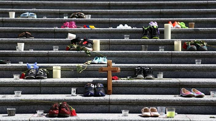 Childrens' shoes at a makeshift memorial in Vancouver