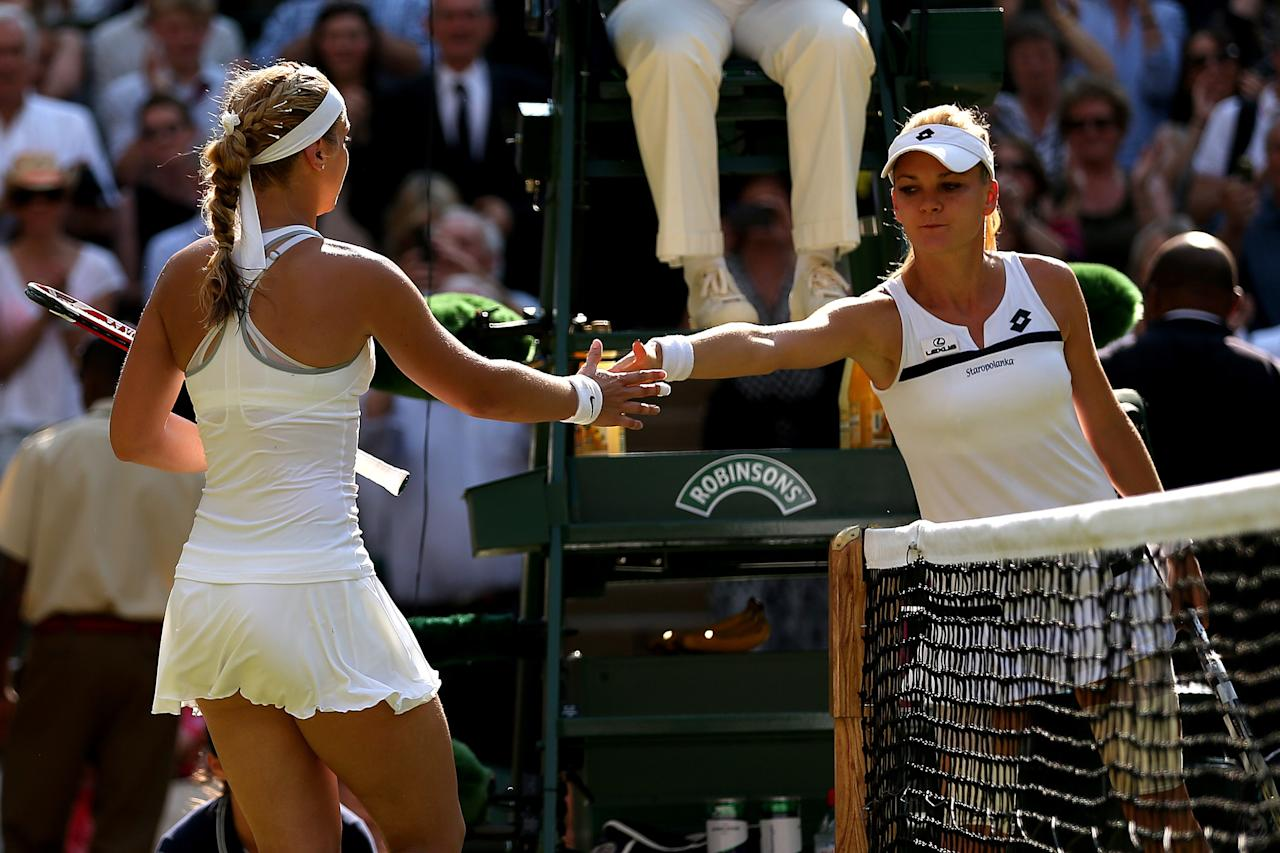 LONDON, ENGLAND - JULY 04: Sabine Lisicki (L) of Germany shakes hands with the defeated Agnieszka Radwanska of Poland following the Ladies' Singles semi final match on day ten of the Wimbledon Lawn Tennis Championships at the All England Lawn Tennis and Croquet Club on July 4, 2013 in London, England. (Photo by Clive Brunskill/Getty Images)