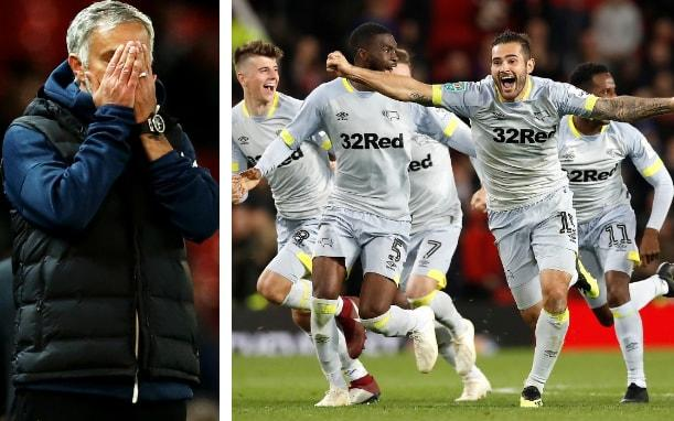 Jose Mourinho (left) holds his head in his hands as Derby celebrate - pa