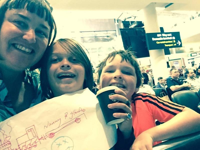 Samantha Fagan with Joshua and Asher waiting for their grandparents at the airport.