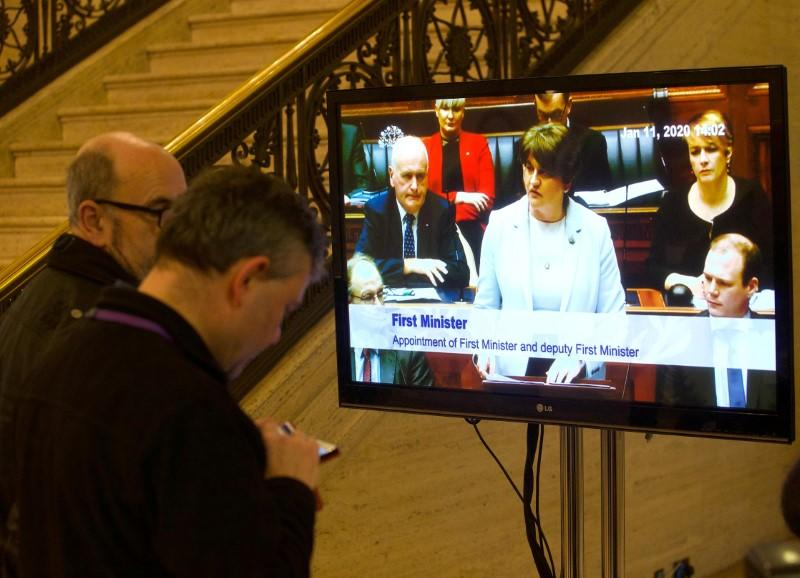 Television screen in the great hall shows First Minister, Arlene Foster speaking as politicians in Northern Ireland returned to the Stormont Assembly after backing a deal to restore devolution in Belfast