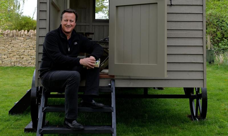 David Cameron sitting outside his shed