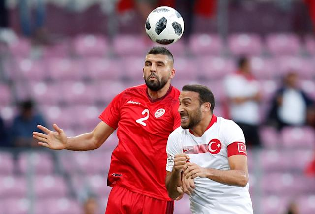 Soccer Football - International Friendly - Tunisia vs Turkey - Stade de Geneve, Geneva, Switzerland - June 1, 2018 Tunisia's Syam Ben Youssef in action with Turkey's Cenk Tosun REUTERS/Denis Balibouse