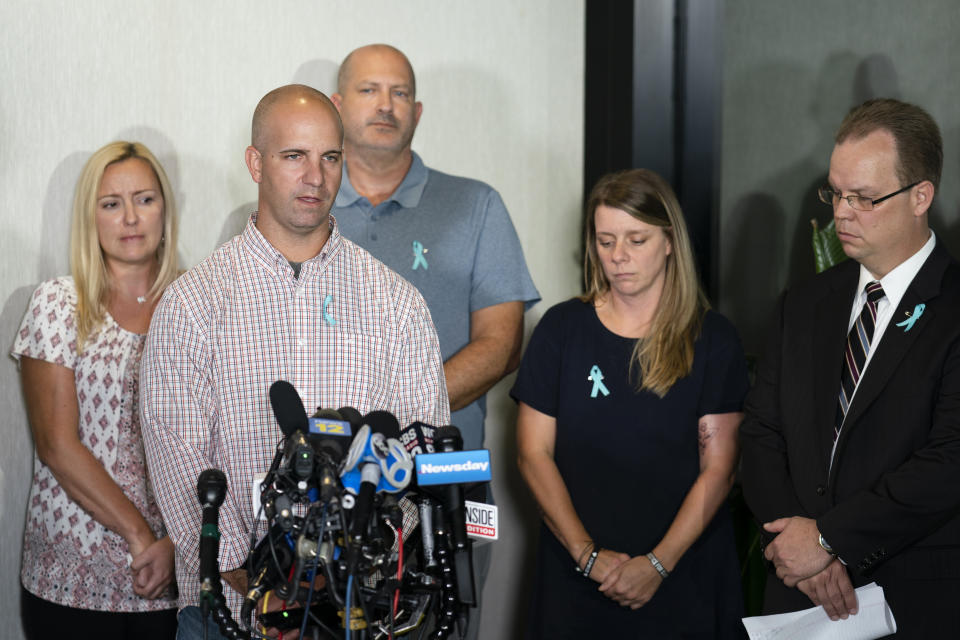 Jim Schmidt, center left, stepfather of Gabby Petito, whose death on a cross-country trip has sparked a manhunt for her boyfriend Brian Laundrie, speaks alongside Joseph Petito, father, center, Nichole Schmidt, mother, center right, Tara Petito, stepmother, left, and the family attorney Richard Stafford, right, during a news conference, Tuesday, Sept. 28, 2021, in Bohemia, N.Y. (AP Photo/John Minchillo)