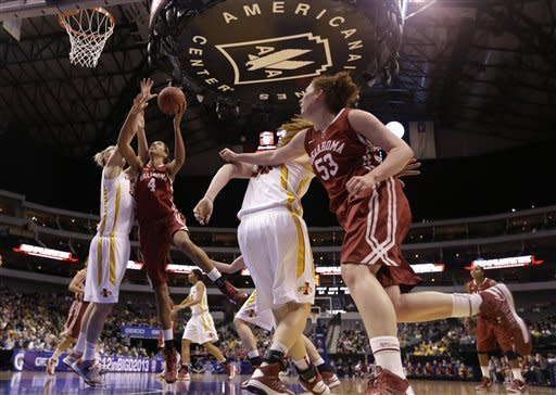 Iowa State center Anna Prins, left, defends against a shot attempt by Oklahoma's Nicole Griffin (4) as Joanna McFarland (53) watches in the first half of an NCAA college basketball game in the Big 12 women's tournament Sunday March 10, 2013, in Dallas. (AP Photo/Tony Gutierrez)