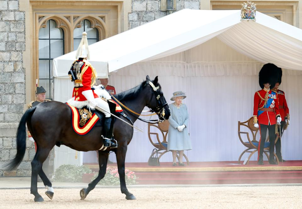 WINDSOR, UNITED KINGDOM - JUNE 12: (EMBARGOED FOR PUBLICATION IN UK NEWSPAPERS UNTIL 24 HOURS AFTER CREATE DATE AND TIME) Queen Elizabeth II accompanied by Prince Edward, Duke of Kent (in his role as Colonel of the Scots Guards) attends a military parade, held by the Household Division (during which The Queen's Colour of F Company Scots Guards will be trooped) in the Quadrangle of Windsor Castle, to mark her Official Birthday on June 12, 2021 in Windsor, England. For the second consecutive year The Queen's Birthday Parade, known as Trooping the Colour, hasn't been able to go ahead in it's traditional form at Buckingham Palace and Horse Guards Parade due to the ongoing COVID-19 Pandemic. (Photo by Max Mumby/Indigo - Pool/Getty Images)
