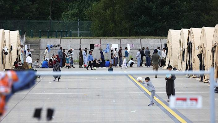 Evacuees from Afghanistan are seen at a temporary emergency shelter at the Ramstein Air Base - 26 August 2021