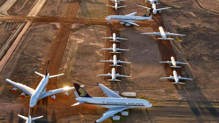 Airbus A380s, Boeing MAX 8s and other smaller aircrafts are seen at a storage facility in Alice Springs, Australia