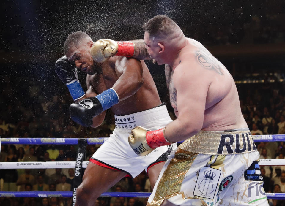 FILE - Andy Ruiz, right, punches Anthony Joshua during the seventh round of a heavyweight championship boxing match in New York, in this Saturday, June 1, 2019, file photo. Andy Ruiz Jr. knows his comeback fight against 40-year-old Chris Arreola has been criticized both for the quality of opponent and the price fans will have to pay to watch it.(AP Photo/Frank Franklin II, File)