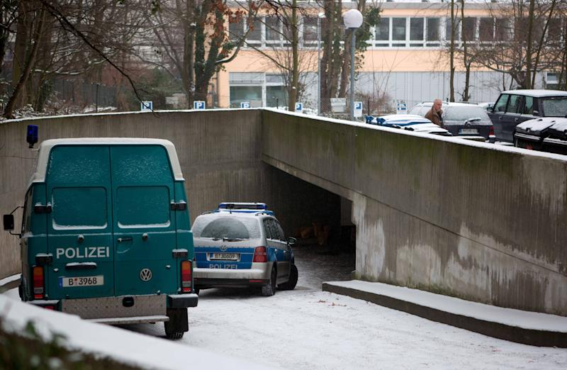 "Police cars stand at the entrance of an underground parking lot in Berlin Monday Jan. 14, 2013. German police say a 30-meter (100-foot) tunnel dug by robbers who raided a Berlin bank was ""very professional"" and must have taken weeks or even months to complete.  Berlin police spokesman Thomas Neuendorf says the tunnel led from the underground garage beneath a green space into the bank's safe deposit room.  Neuendorf told The Associated Press on Monday that the tunnel was elaborately constructed and even had ceiling supports to stop it collapsing.   Police are still trying to determine what valuables were stolen from the deposit boxes. (AP Photo/dapd/ Tobias Koch)"